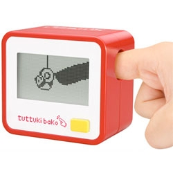 So strange - the Tuttuki Bako, an interactive game system that requires you to insert your finger into the device to interact with the games. The display shows a digital replica of your finger - you can then play with a panda or annoy a girl by touching her face.