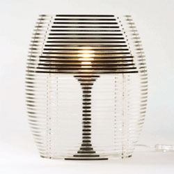 Studio Mango created the Sliced lamp by cutting up an old fashioned table lamp and dividing it over 40 Perspex plates.