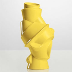 Michael Geertsen's Closely Separated Vase for Muuto. Inspired by a stack of dishes, the vase is available in white and yellow. A visual reminder of the beauty in disharmony.