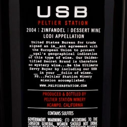 "6 West Design created this bottle for USB wine - due to TTB/Cola regulations, new wineries can't use the term ""Port"" (to protect Portugal's geographic indication). The packaging playfully incorporates words that imply the missing word (im____ant)."