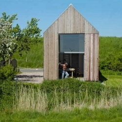 """""""Haus IK_13"""" by Mitto Architekten. A tiny wooden house and artist studio in Borsfleth - Germany."""