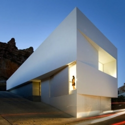 House in Ayora - Spain by Fran Silvestre Arquitectos. A white concrete house in the mountain, facing Ayora Valley.
