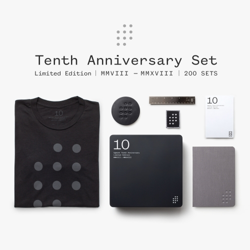 To celebrate 10 years, Ugmonk released a special Limited Edition 10th Anniversary Set. Included in the set: bamboo/organize cotton tee, laser-cut metal ruler, cloth-cover notebook, patch, leather coaster, and matte black tin.
