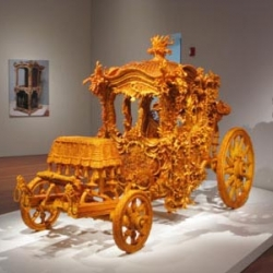 "Australian artist Timothy Horn's exhibition 'Bitter Suite' at the de Young Museum in San Francisco. ""Mother-Load,"" shown here, is a child-size Cinderella carriage encrusted in crystallized rock sugar.."