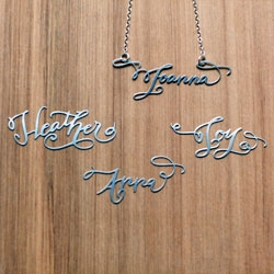 The Calligraphy Necklace by Brevity - each custom necklace is hand lettered by calligrapher Crystal Kluge, creating a one-of-a-kind necklace as unique as the wearer.