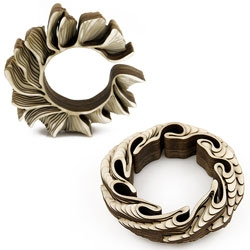 Amazing jewelry by Anthony Roussel, who laser cuts and then layers sculptural jewelry pieces.