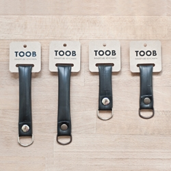 TOOB is a keychain made of recycled bicycle innertubes collected from Tel Aviv's local bicycle workshops. By Roy Sherizly.