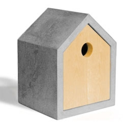 Torsten Klocke designed this beautiful birdhouse - Rohbau - a concrete shell in an iconic form.