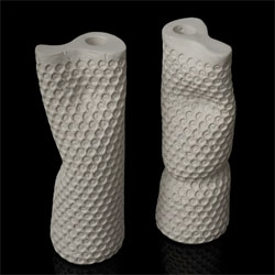 Alexis Themistocleous's Caged Message vases are cast in bubble wrap and contain secret messages that are laser-cut into stainless steel. The messages can only be revealed when the vases are smashed.