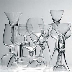 Karim Rashid's Happy People glassware is designed to be reversible - eg. a margarita glass that becomes a shot glass when reversed. Love all of the contrasting shapes.