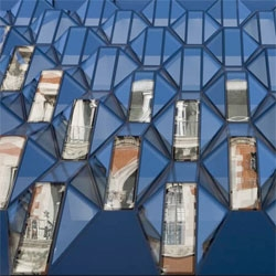 "Intriguing facade by Future Systems on London's Oxford Street. They call it a ""vibrant jewel-like glass frontage...Through the repetition of crystal-like glass bays, a sense of scale and rhythm is created."""