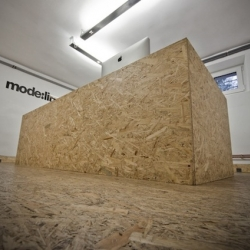"""OSB Office"" in Poznan by Paweł Garus and Jerzy Woźniak from design studio mode:lina. A low budget design using OSB panels for floor and furnitures."