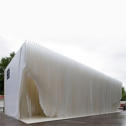 Olga Sanina + Marcelo Dantas designed the Ayuntamento de Madrid Book Fair Pavilion - a series of plastic topographical sheets layered to create an interior space.