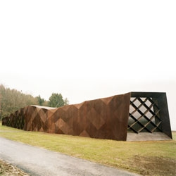 Sited on a former concentration camp in Hinzert, Wandel Höfer Lorch + Hirsch have designed a memorial and exhibition space. I like the elongated shape and the triangulated steel facade.