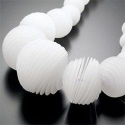 Jahyun Rita Baek uses cut acrylic to topographically create geometric forms. Really beautiful work!