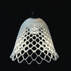 "Designed by Alain Jost and edited by Brandnewdesign ""Fibonacci"" Lamp consists of a silicone flexible honeycomb structure. It expands and takes shape when suspended."