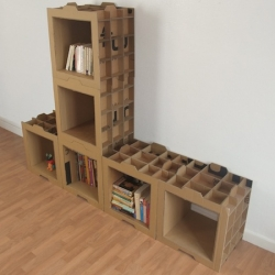 """800gr"" bookshelf by french designer Dany Gilles is made of stackable cardboard cases. Light and modular."