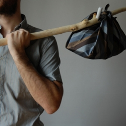 Faggötteen aims to be an ode to slowness and wandering, to the kind of mobility when baggage was essential. The wooden stick has been obtained from pruning a fig tree which otherwise would have been thrown in the rubbish. Bindle!  Faggotteen is intended to suggest a different interaction between man and object - in which each part is involved – following the current trend that reclaims the slow elegance of activity, far from industrial rhythms.