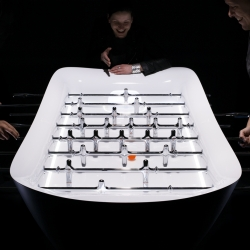 gro design's awesome fusball table , entirely machined out of acrylic and aluminium, a delightful piece of design and a refreshing take on a really old game...