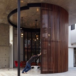Voila House - a house with a circular door that transforms the inside to the outside instantly by Fabian Tan Architect