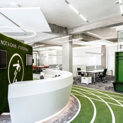 Munich-based architecture firm TKEZ designed a 1,400 smq office for Onefootball inside an old factory building in Berlin, Germany.