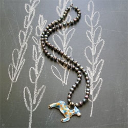 Quirky jewelry by Natural Historie - love this cloisonne deer on a strand of pearls.