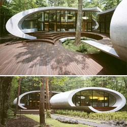 Futuristic Shell House by Kotaro Ide. The volumes are raised above the ground a bit and appear to float.