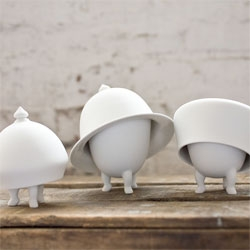 Jorine Oosterhoff's playful Mad Hatter tableware. Love the oversized lids.