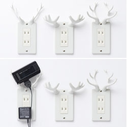 Nendo's Socket Deers - electrical outlet covers that you can rest your phone on as it charges - plus they look super cool! They are covered with a urethane rubber that keeps the phone from slipping and protects the antlers from breaking when bumped.
