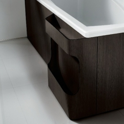 Bathtub panels including towel rail and laundry basket by Roca.