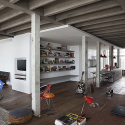 Wide open contemporary loft in Oscar Niemeyr's Copan by young architects Felipe Hess and Renata Pedrosa.