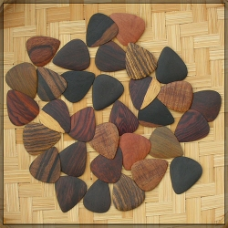 Handmade guitar wood picks in various hardwoods... good way to use up those wood scraps.