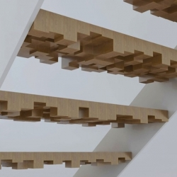 Sculptural and dramatic stairs by E-Stairs. Made of wood, glass and steel.