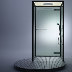 'Booth' is a minimalist shower with an uncommon circular platform by Inax.