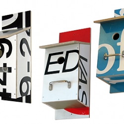 i'm loving bomdesign's birdhouses.  theyre made from recycled billboards.
