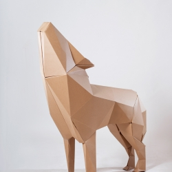 Polygonal cardboard-made wolf part of Li'l Red Riding Hood installation by Cazapapeles.
