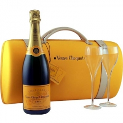 I've been in love with the Veuve Clicquot Champagne Glass shape since i took that trip...  the Veuve Clicquot City Traveler Case Yellow Label Brut Champagne 2 glass set is only $50! (Nicely packaged too!)