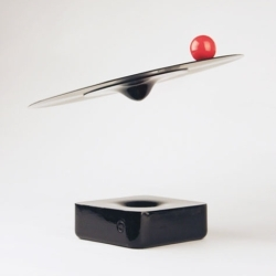 Record player using a carrier and dock outfitted with a magnetic and auto-calibrating control system which carries the LP into thin air as it is playing music. The red sphere, contains a needle, amplifier and speaker.