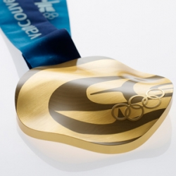 VANOC has unveiled the 2010 Olympic medals - each is casted from re-used circuit boards,  laser engraved with a unique pattern (each medal is different), and the form factor represents the landscape of Vancouver