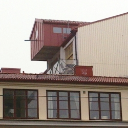 On top of a building in Gothenburg , Sweden there are two birdhouses in full Size for living or office. Fun and playful.