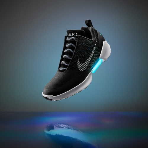"Nike Hyperadapt 1.0 features adaptive lacing. ""When you step in, your heel will hit a sensor and the system will automatically tighten. Then there are two buttons on the side to tighten and loosen."""