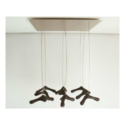 These suspension hangers by Dutch designers Ariëtte Bos and Tom Couvée make your clothes look as if they are flying.