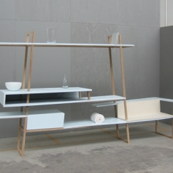 Wall and Piece' was conceived as a piece of furniture as meeting point. The oak frame supports steel plates at cleverly considered heights: sitting height, table height, counter height, bar height and the highest plate at a height which you can just about reach.