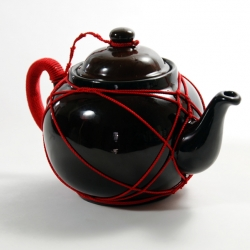 Redstr/collective & Copal present The Slave Betty, a traditional British Teapot captured and harnessed in the ancient art of Japanese Shibari (rope bondage). This East-meets-West teapot is suspended for its master and made available for all to enjoy.