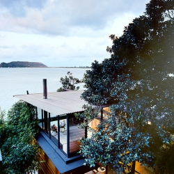 Hidden on a hill overlooking Australia's Pittwater Bay, Rob Brown's design for the James-Robertson house happily opens itself (and its occupants) to all that Mother Nature can dish out.