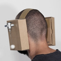 Zimoun's Cardboard Headphones made with cotton balls and dc motors.
