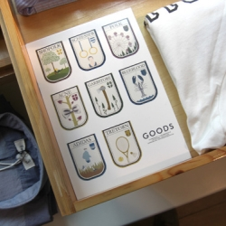 Goods is a small fashion store in Copenhagen run by Kasper Hostrup, that presents the brands they work with in a charming way. Unique coat of arms designed by Anders Arhøj.
