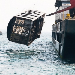 In 2000, the NYC Transit Authority joined the artificial reef building program. Hundreds of stripped/decontaminated subway cars were sent to be dumped in the Atlantic Ocean. Captured in 'Next Stop Atlantic' by Stephen Mallon.