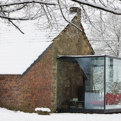 House ROLY by Belgian architects AABE Erpicum & Partners: a small outbuilding which has been extended and transformed this house into a bed and breakfast.