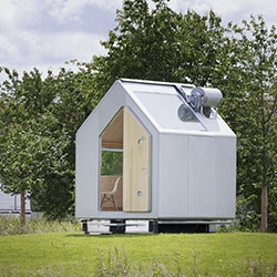 'Diogene' - a tiny house at the Vitra Campus designed by Renzo Piano Building Workshop. Despite its modest dimensions, the house is completely autonomous and has everything needed for a normal person's living.